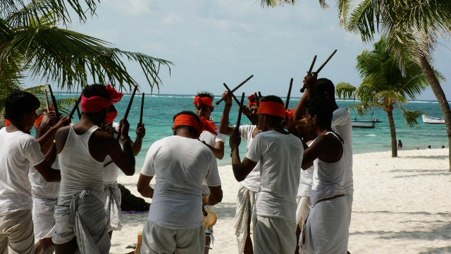Male islanders of Minicoy (South Lakshadwip) wear Dhotis and dance.